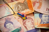 National currency of Venezuela - Bolivar. Suspension - souvenir, painted in the colors of the flag of Venezuela — Stock Photo