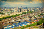 Cityscape of Moscow. Railroad depot in the foreground. railway train. Photo tinted in yellow — Stock Photo
