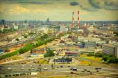 Cityscape of Moscow, Russia. Industrial Area, road with cars in the foreground. Photo tinted in yellow — Stock Photo