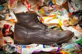 Men's leather boots crumpled sheets of colored paper. Autumn - spring shoes in grunge style. — Stock Photo