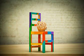 Decorative ball made of wood and toy chair. Contemporary Art — Stock Photo