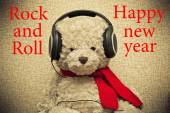 Teddy bear with headphones.Rock and roll and a happy new year — Stock Photo