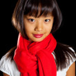 Beautiful smiling Asian girl in a red scarf. Girl Korean nationality — Stock Photo #59114779