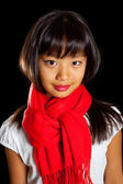 Beautiful smiling Asian girl in a red scarf. Girl Korean nationality — Stock Photo