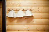 Hats for sauna and bath hanging on the hanger — Stock Photo