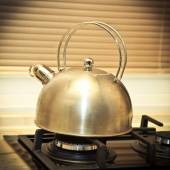Not very clean whistling kettle on the stove. kitchenware — Stockfoto