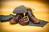 Fashion leather shoes, belt buckle, knitted scarf and hat. Autumn still life of clothes — ストック写真