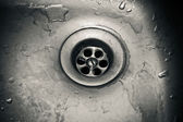 Drain hole in a dirty sink close up — Stock Photo
