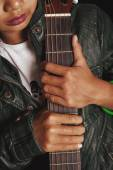 Female hands holding an acoustic guitar — Stockfoto