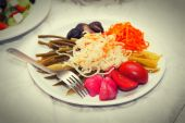 Dish with marinated pickles - garlic, tomato, cabbage, pepper, leek — Stock Photo
