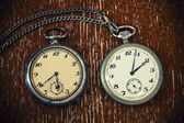 Retro watch on a chain on a vintage wooden background — Fotografia Stock