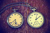 Vintage watch with chain on vintage background — Stock Photo