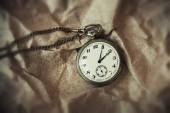 Vintage retro pocket watch on a chain on a vintage background — Foto de Stock