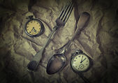 Antique silver cutlery - fork and false and vintage pocket watch on vintage background — 图库照片