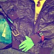 Fashionable clothes: blue jeans with a leather belt, leather jacket, T-shirt, watches, sunglasses, bracelet on the arm, glove, 5 Euro banknote — Photo #67915781