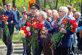 MOSCOW, RUSSIA - MAY 9: World War II veterans are with bouquets of flowers at the Victory Day celebrations. May 9, 2013 in Moscow, Russia. — Stock Photo