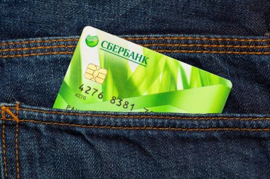 MOSCOW, RUSSIA - FEBRUARY 6, 2016: Sberbank plastic card in the back pocket of jeans. Sberbank - the largest bank in the Russian Federation