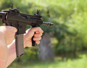 Soldier  shoot at a target with automatic weapon — Stock Photo