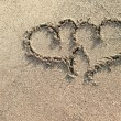 Two hearts written on the sand. — Stock Photo #53695655