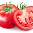 Hole tomato and half with water drops on them. — Stock Photo #53695819