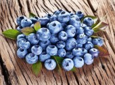 Blueberries over old wooden table. — Foto de Stock