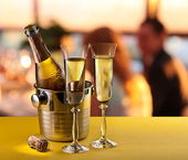 Champagne flutes and chilled bottle. — Stock Photo
