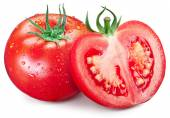 Hole tomato and half with water drops on them. — Foto de Stock