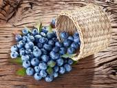 Blueberries over old wooden table. — Stock Photo