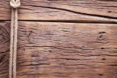 Sailor's knot over old wooden background. — Stock Photo