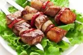 Grilled kebab (shashlik) on spits. — Stock Photo