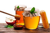 Glass cans full of honey, apples and honeycombs wood. File conta — Stock Photo