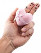 Couple painted on man's fingers and gift box in the form of hear — Stock Photo