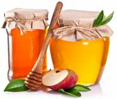 Glass cans full of honey, piece of apple and honey dipper on whi — Stock Photo