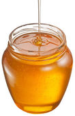 Honey flowing into glass jar. File contains clipping paths.  — Stock Photo