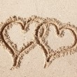 Hearts drawn on the beach sand. — Stock Photo #63923027
