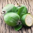 Feijoa fruits on old wooden table. — Stock Photo #64659263