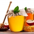 Glass cans full of honey, apples and honeycombs on wood. Clippin — Stock Photo #64659331
