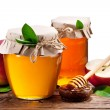 Glass cans full of honey and apples on wood. Clipping paths. — Stock Photo #64659333