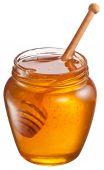 Glass can full of honey and wooden stick in it. Clipping paths. — Stock Photo