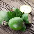 Feijoa fruits on old wooden table. — Stock Photo #65779983
