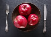 Red apples and table settings on a grey background. — Foto de Stock