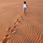 Baby - girl running in the desert. — Stock Photo #65781335