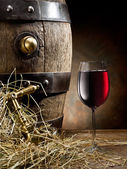 Still-life with glass of wine and barrel. — Stock Photo
