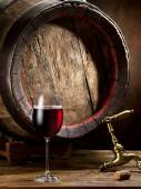 Still-life with glass of wine, bottle and barrel. — Stock Photo