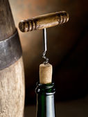 Opening of a wine bottle with corkscrew. — Stock Photo