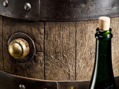 Old oak wine barrel and wine bottle. — Stock Photo