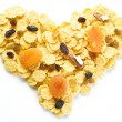 Cornflakes arranged in the shape of heart. — Stock Photo #72778889