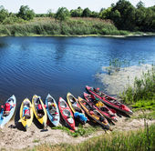 Canoes on a river-bank. — Stock Photo