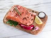Fresh salmon on the cutting board. — Stock Photo