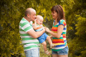 Happy family having fun outdoors on a summer day — Stock Photo